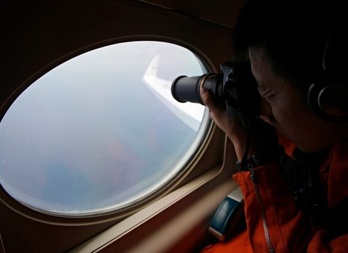 Search for missing Malaysian plane suspended, families cry foul