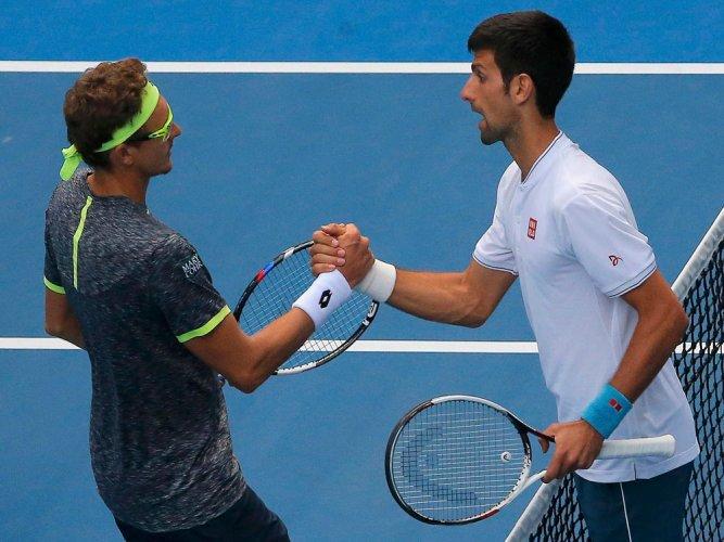 Defending champ Djokovic stunned by Istomin