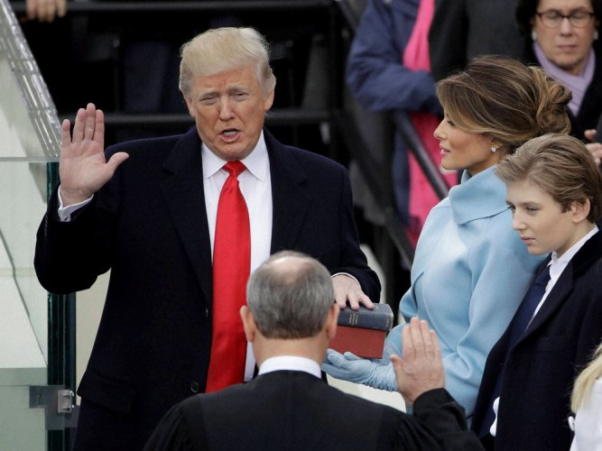 Trump takes oath; vows to set course for US, world