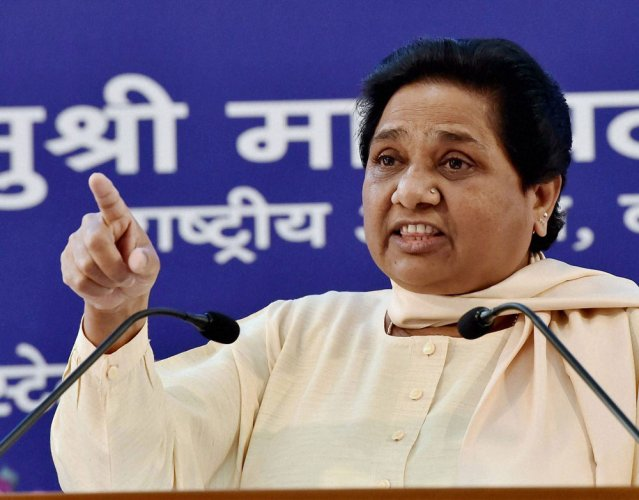 RSS, BJP should desist from issuing threats over quota:Mayawati