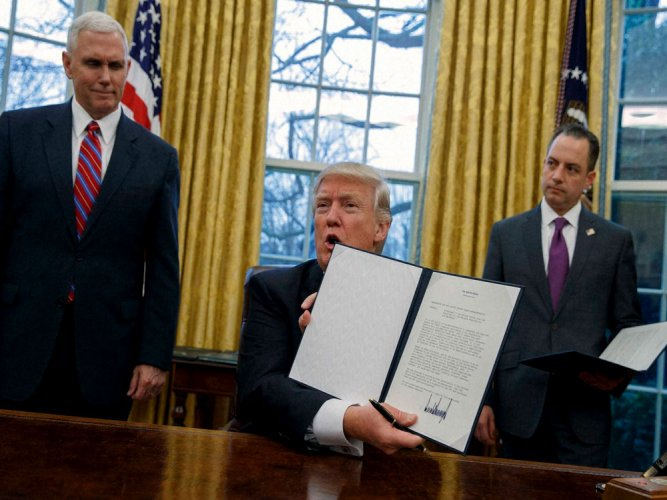Trump moves to withdraw from TPP trade pact
