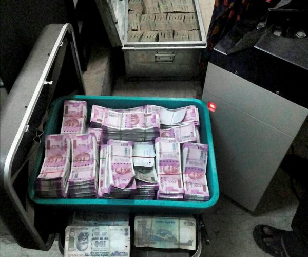 Raids on Cong leader, minister yield Rs 162 cr