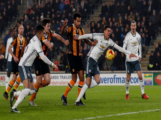 Man Utd survive Hull scare to reach League Cup final