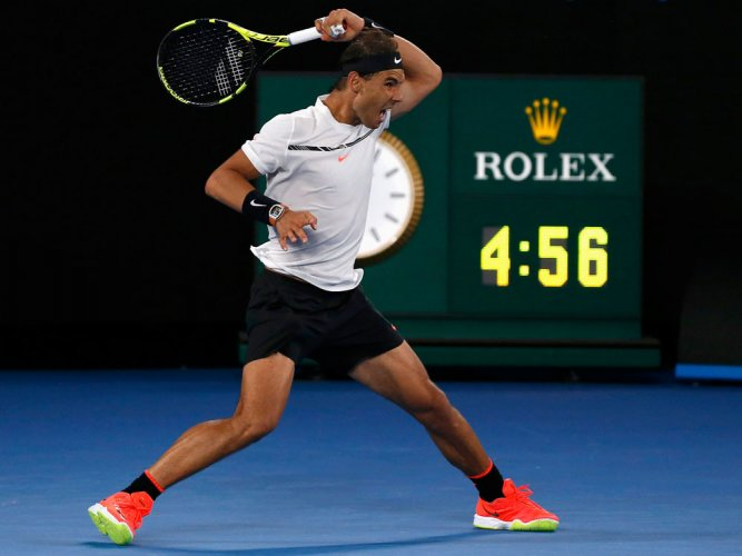Nadal edges classic to reach Federer final