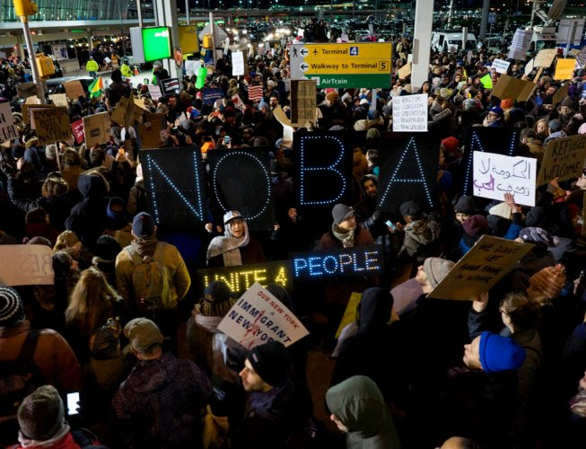 Trump's immigration ban triggers protest at airports across US