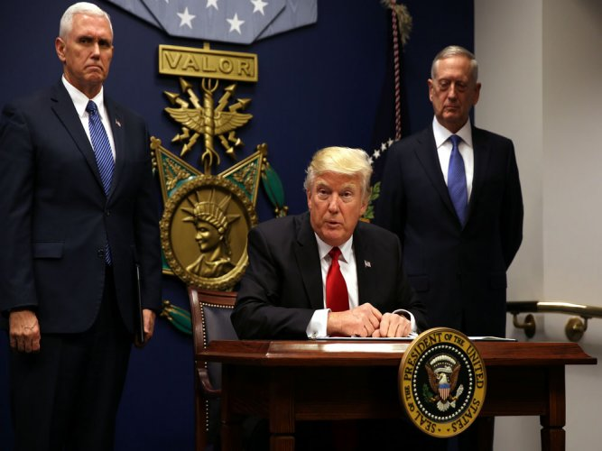 Trump defends his executive orders, says world a horrible mess
