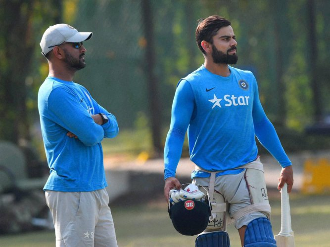 Kohli is learning captaincy tricks from Dhoni