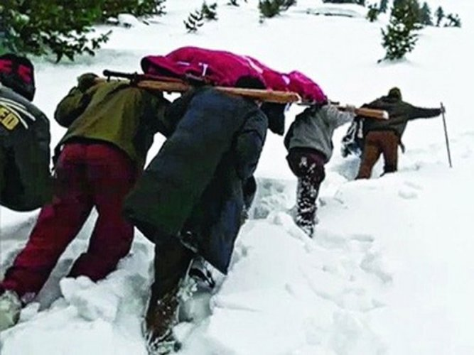 Army jawan treks through snow, carries mother's body on shoulder