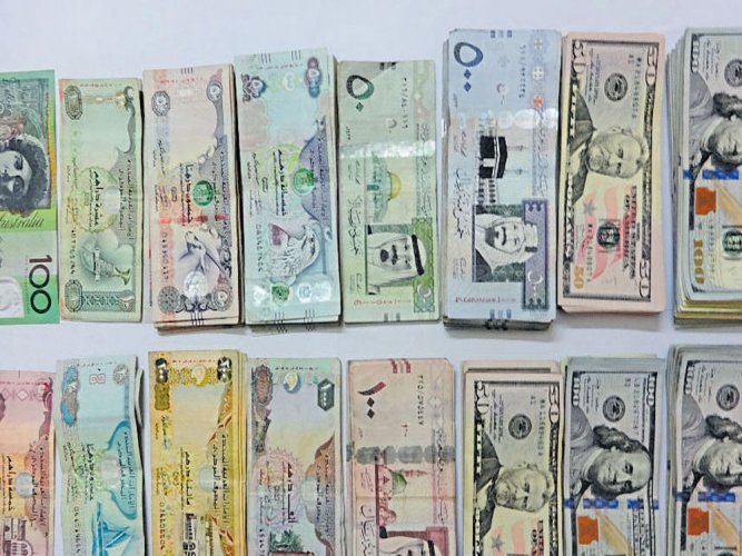 Dubai-bound man held with foreign currencies concealed in tea packets