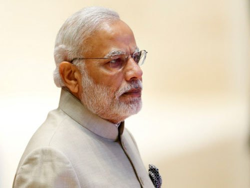 Modi questions inaction against K'taka minister raided by I-T dept