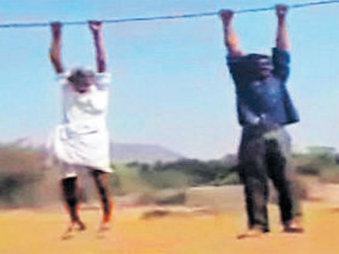 Men hoisted on cable come crashing down