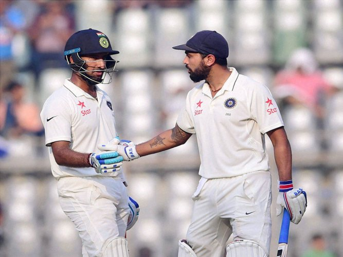 Vijay, Pujara take India to 206/2