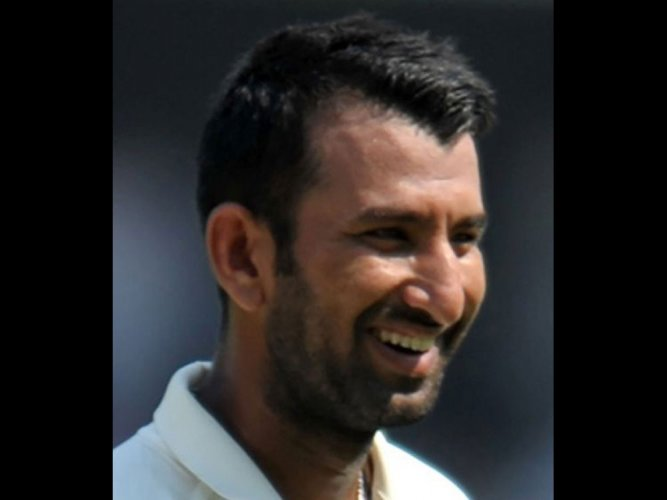 Pujara moves past Borde's record