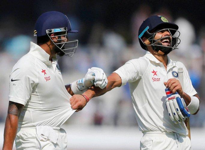 Vijay, Kohli put India on top