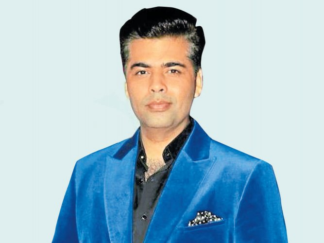 I'm afraid to go out for dinner with another man: Karan Johar