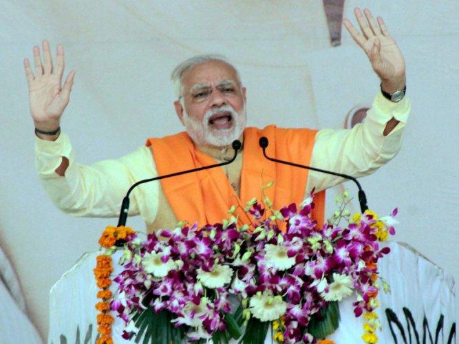 Modi seeks to puncture 'kaam bolta hai' slogan of Akhilesh