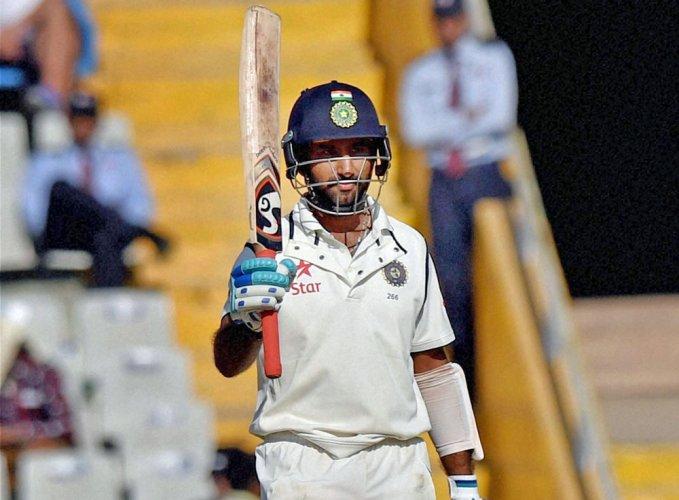 Pujara hopes to shed 'slow' perception