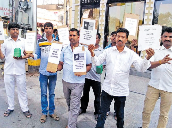 Protesting Ola, Uber cab drivers start fundraiser to 'pay off' govt