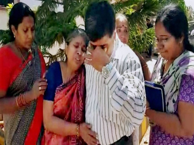 Grieving family receives techie's body