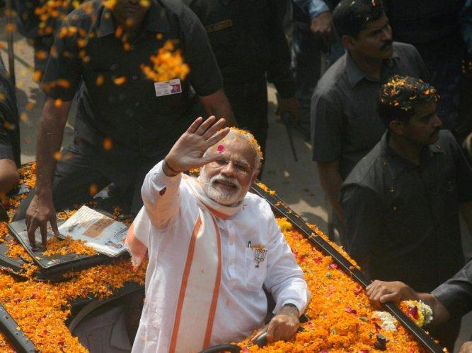 In Varanasi, Modi leads road show; prays at historic temples