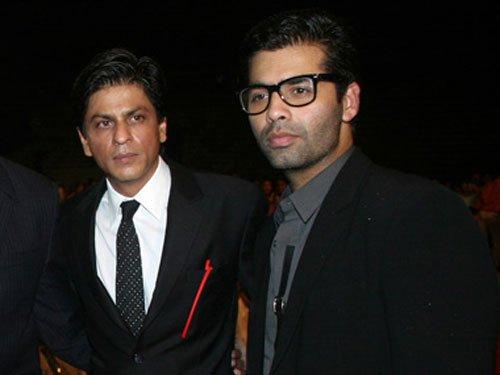 SRK extends wishes to Karan Johar on parenthood