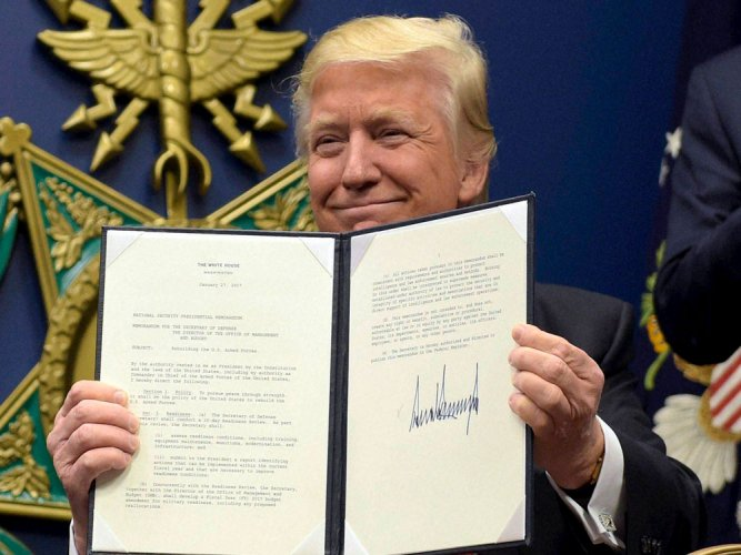 Hawaii becomes 1st state to sue over Trump's new travel ban