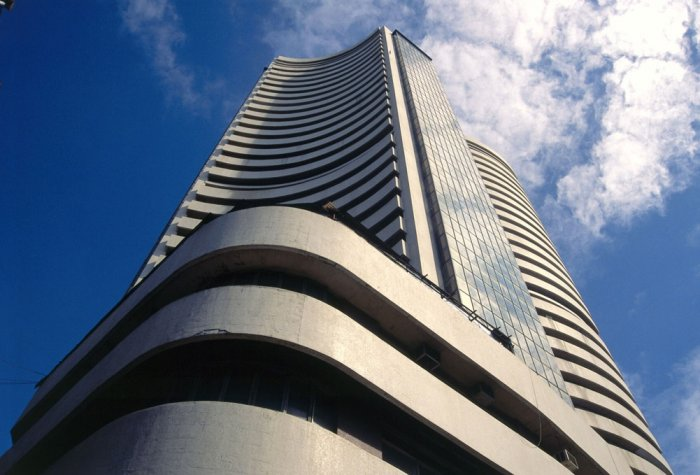 Sensex ends in green, but caution rules