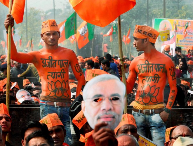 BJP sweeps UP, Cong wrests Punjab
