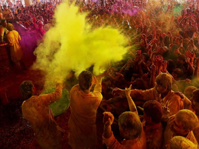 Riot of colours as India plays Holi