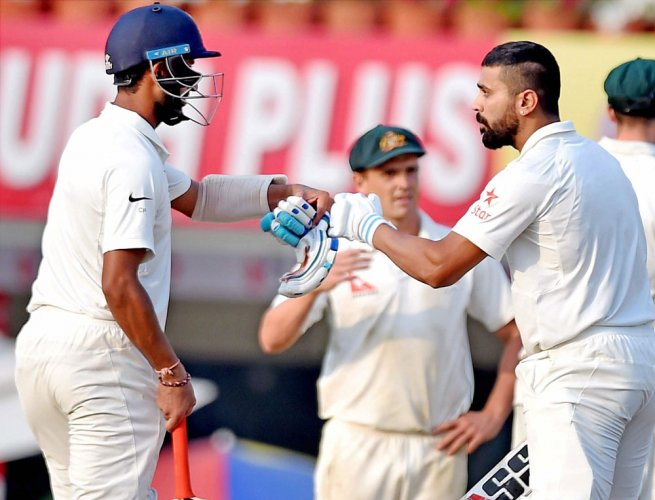 Pujara's defiant century guides India to 360/6