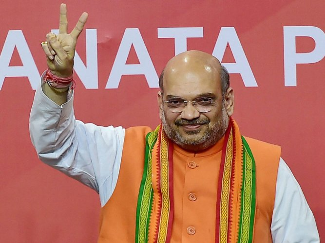 Shah persuades, Modi relents