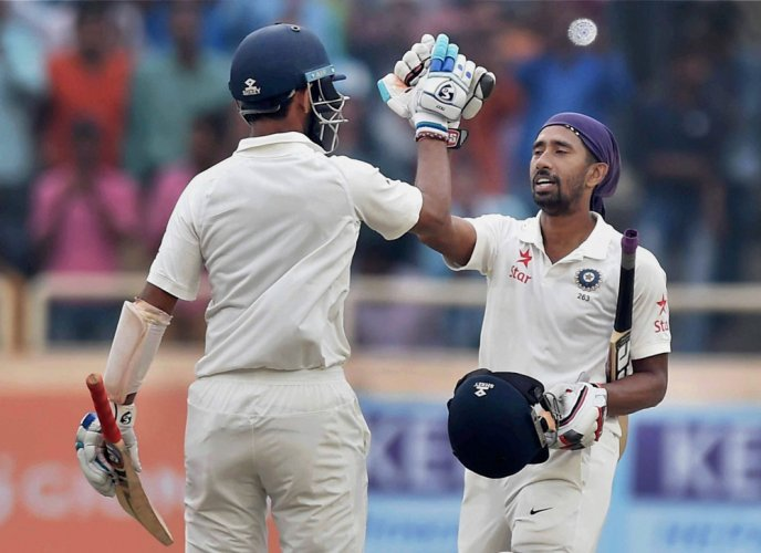 Pujara double, Saha ton put India in complete command