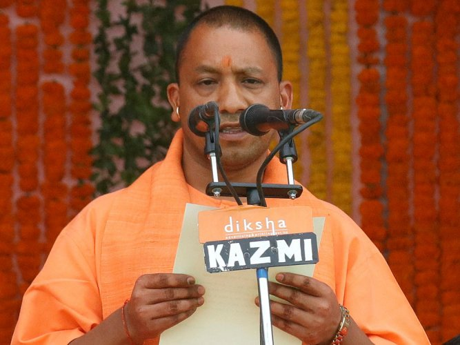 Adityanath takes charge of UP with jumbo cabinet