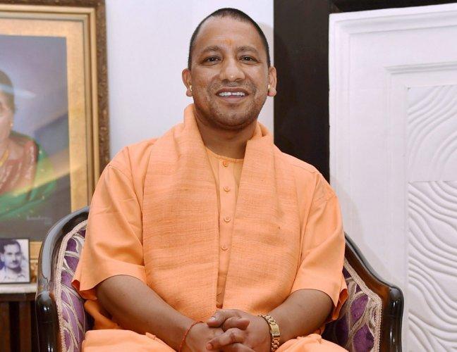 Adityanath allocates portfolios, keeps Home ministry