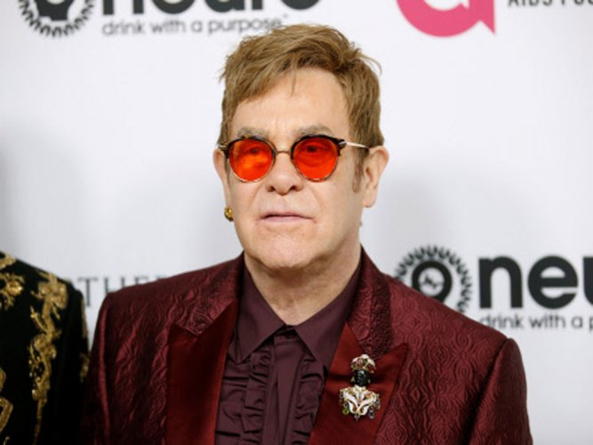 Hollywood celebs ring in Elton John's 70th birthday