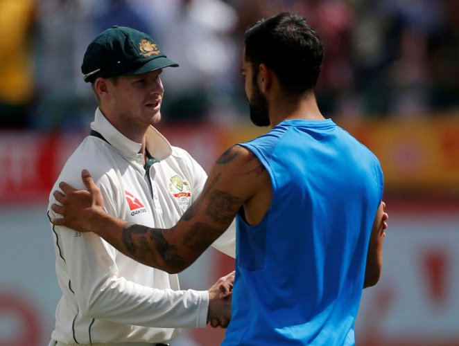 Smith offers beer to Rahane and Indian team