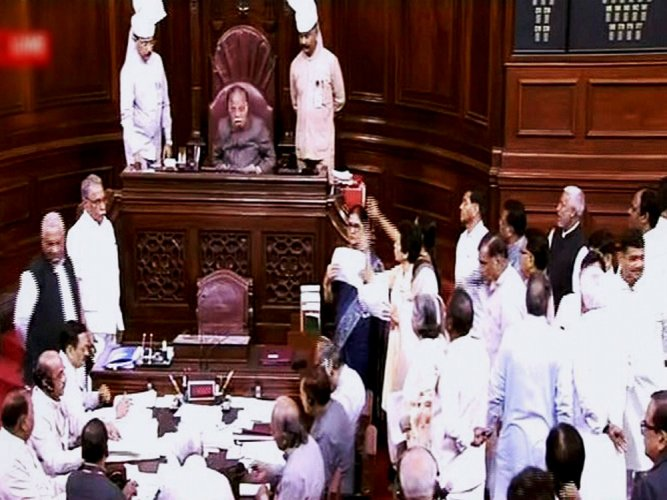 Parrikar comes to RS; Cong MPs protest
