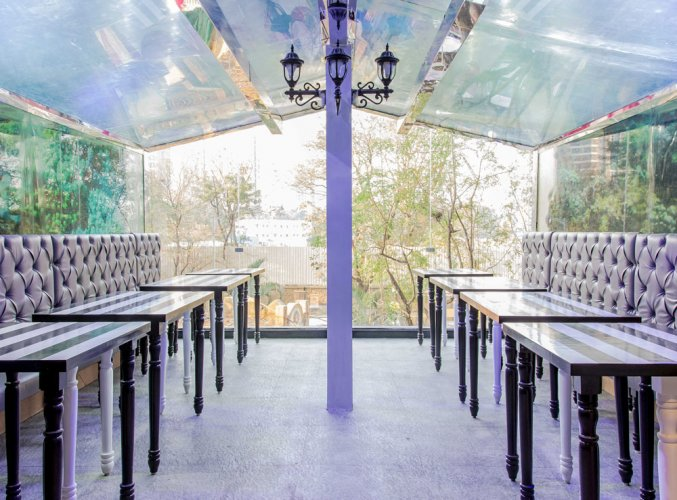Dine here with fish hovering around