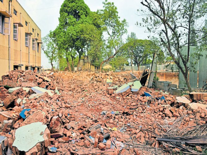Building demolition in progress  for Whitefield Metro line