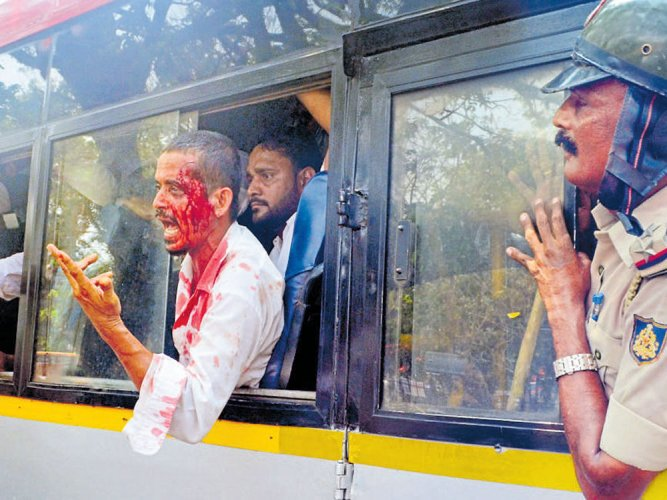 PFI activists caned for pelting cops with stones