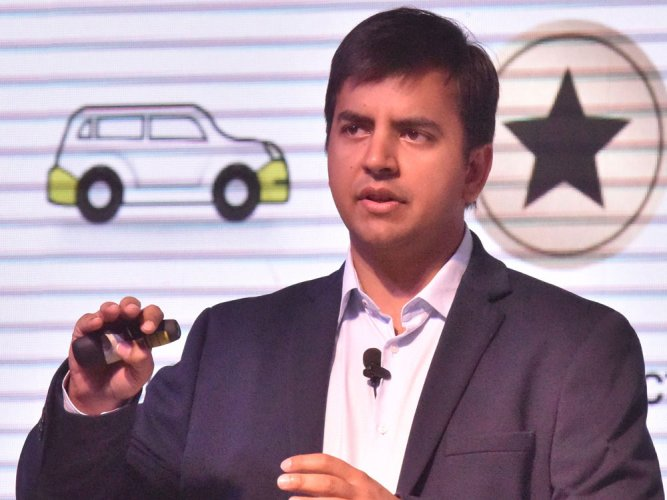 It is a war with Uber, co will be profitable in 2 yrs: Ola CEO