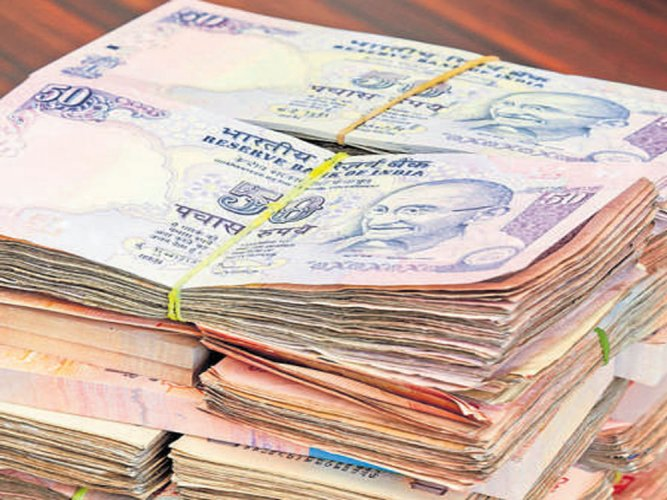 Poll officials seize Rs 20 lakh from minister's aide