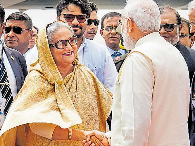 Modi ignores protocol, receives Hasina at airport