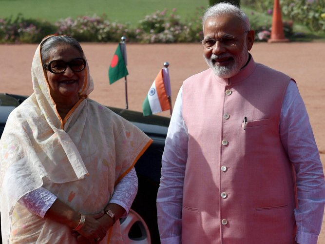 India-Bangla ink 22 pacts; PM assures early solution on Teesta