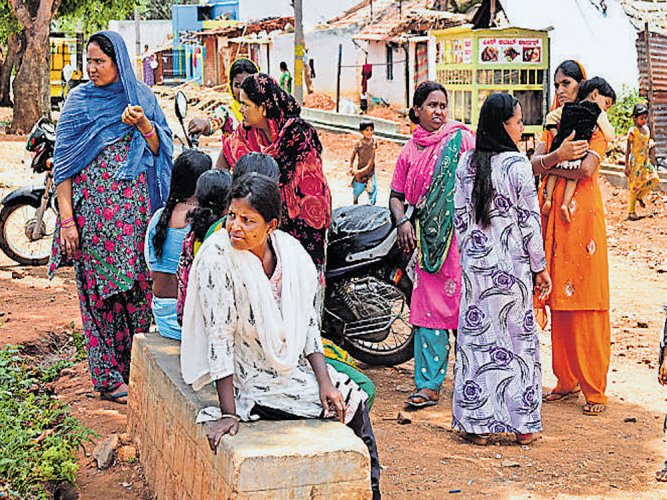 After much persuasion, reluctant villagers cast votes
