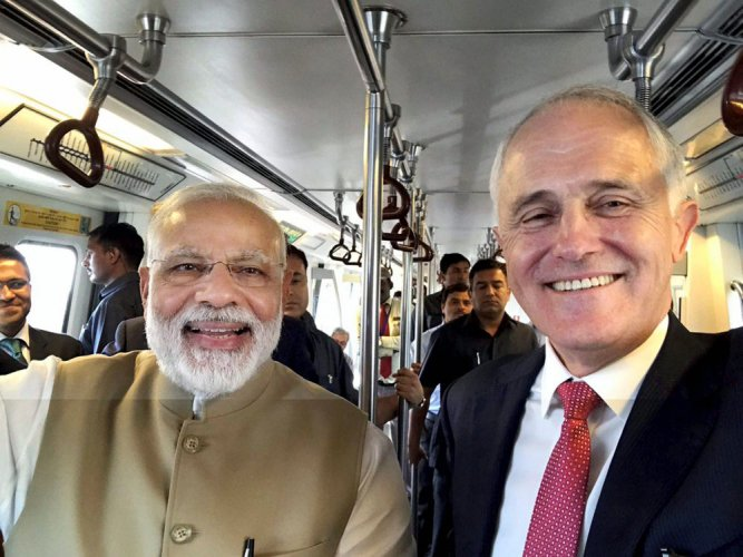 Modi-Turnbull day out: Purchase metro token, visit Akshardham