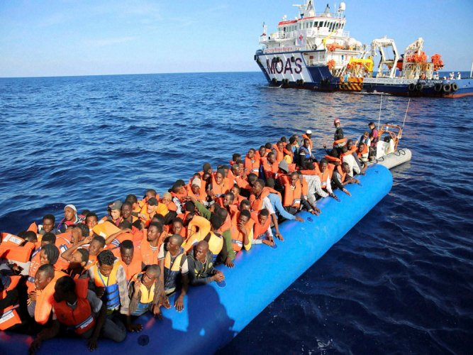 At least 97 migrants missing as boat sinks off Libya
