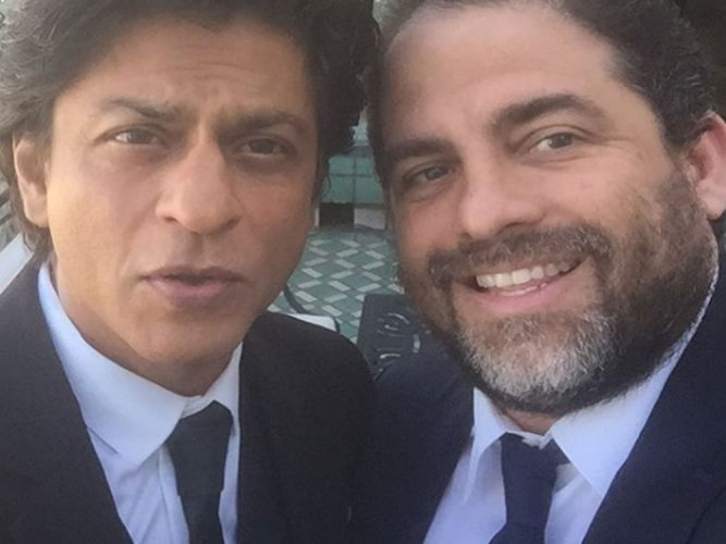 Shah Rukh teaches Brett Ratner 'Lungi dance'