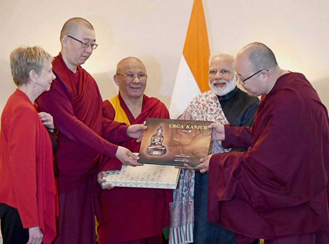 Modi presents 'Urga Kanjur' to Buddist temple head priest