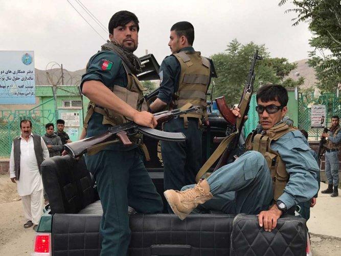 Explosions rock funeral in tense Kabul